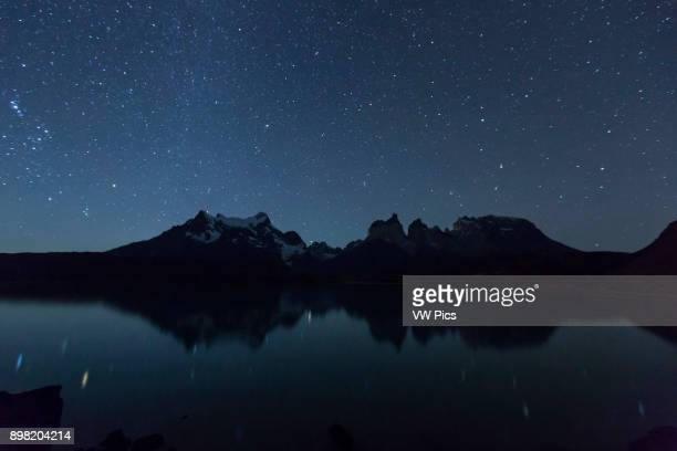 Stars and night landscape of the Paine Massif across Lake Pehoe in Torres del Paine National Park Patagonia Chile A UNESCO World Biosphere Reserve...