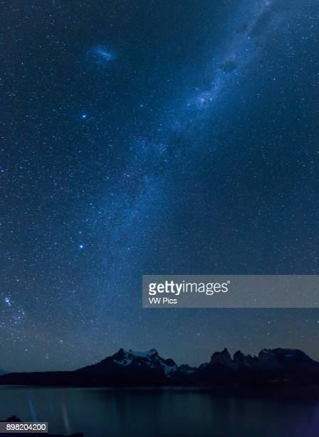 Stars and night landscape of the Paine Massif and the Cuernos across Lake Pehoe in Torres del Paine National Park Patagonia Chile A UNESCO World...