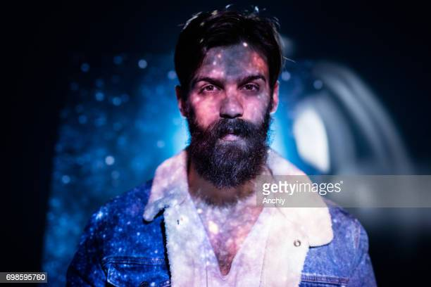 stars and sky image projected on a bearded man's upper boddy. - projection equipment stock pictures, royalty-free photos & images