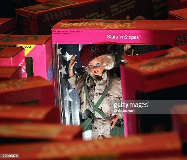 Stars and Stripes Barbie is seen amongst pink boxes of barbie dolls at Christies South Kensington as part of a collection of 4000 barbie dolls that...