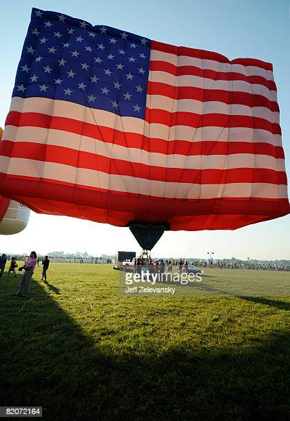 Stars and Stripes hot air balloon fills before rising into the sky at the 26th Annual Quick Chek New Jersey Festival of Ballooning at the Solberg...