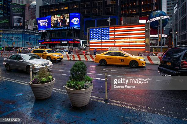 Stars and stripes light the times square on a rainy day in New York City.