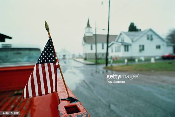 stars and stripes on back of pickup truck, usa - small town america stock pictures, royalty-free photos & images