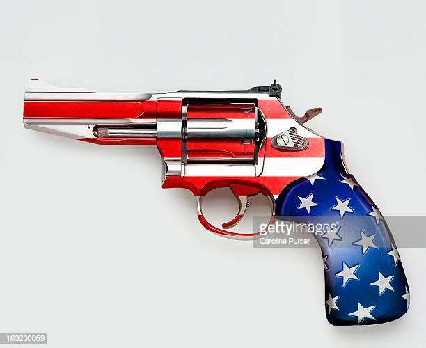stars and stripes on gun - guns stock photos and pictures