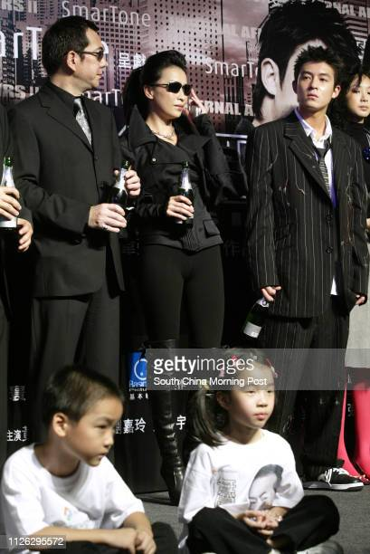 Stars Anthony Wong Chausang Carina Lau Kaling and Edison Chen Koonhei in the premiere of Infernal Affairs II at the UA theatre in Times Square 29...