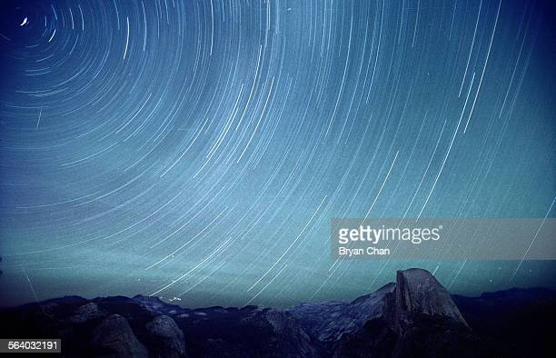 Stars appear to swirl around the North Star in this time exposure at Glacier Point in Yosemite National Park At right is Half dome FILM IMAGE