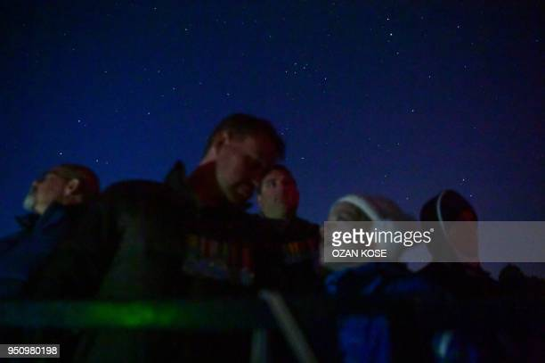 Stars are seen as people attend a dawn service marking the 103rd anniversary of ANZAC Day in Canakkale Turkey on April 25 2018 The April 25 1915...