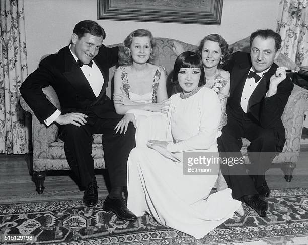 Stars At A Party Prominent film players pose for their pictures during the party given by Harry Lachman movie executive in his home at Beverly Hills...