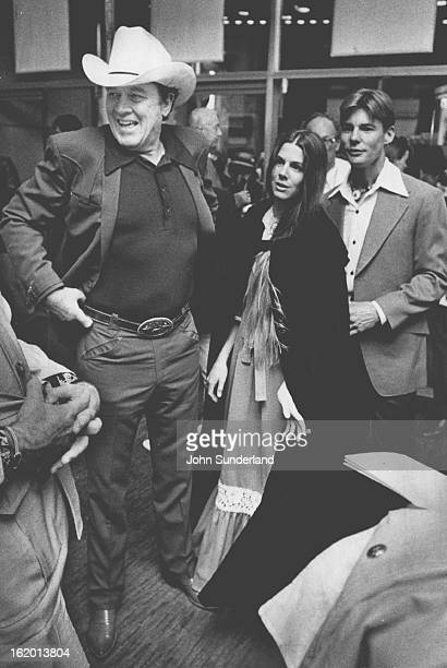 1975 JUN 19 1975 APR 30 1981 MAY 3 1981 Stars Attend American Premiere Of 'Bite The Bullet' Ben Johnson left Bonnie Vincent wife of actor JanMichael...