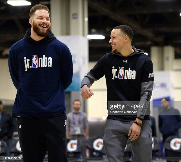 NBA stars Blake Griffin of the Detroit Pistons and Golden State Warriors guard Stephen Curry right joke around during the Fourth Annual Jr NBA Day at...