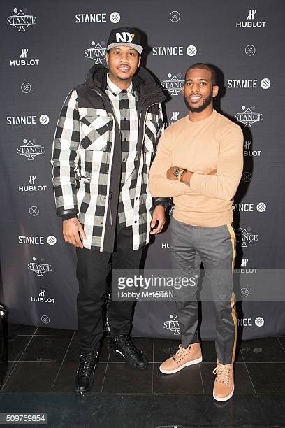 Stars Carmelo Anthony and Chris Paul at red carpet during the Dwyane Wade and Stance Stocks Spades Tournament at The One Eighty on February 11 2016...