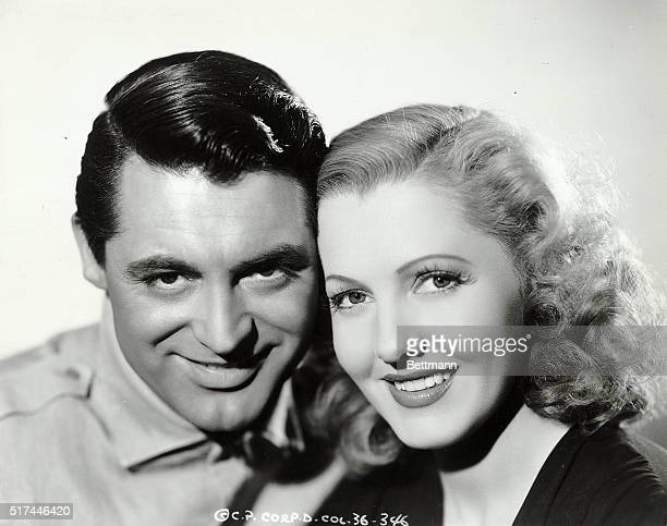 Stars Cary Grant and Jean Arthur smile for a head and shoulder publicity portrait to advertise Only Angels Have Wings directed by Howard Hawks