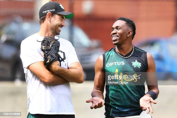 Stars coach Stephen Fleming listens to Dwayne Bravo bats during a Melbourne Stars Big Bash League media opportunity at CitiPower Centre on December...