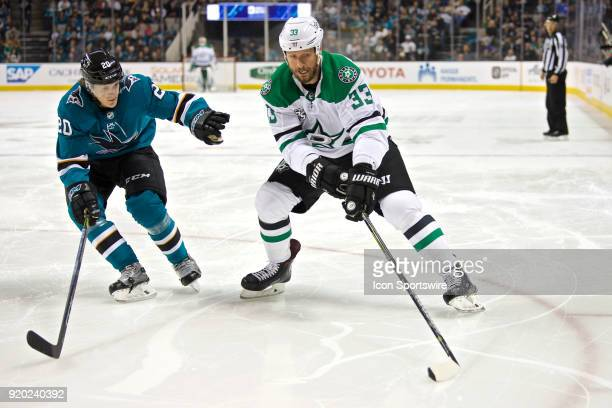 Stars defenseman Marc Methot keeps the puck away from Sharks left wing Marcus Sorensen during the NHL game between the San Jose Sharks and the Dallas...