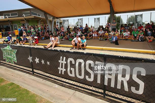 Stars fans look on as The Stars bowl against the Premier All Stars at Casey Fields during Melbourne Stars Family Day on December 13 2015 in Melbourne...