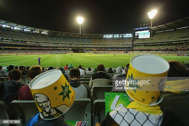 Stars fans wearing KFC buckets on their head watch the game during the Big Bash League Semi Final match between the Melbourne Stars and the Hobart...
