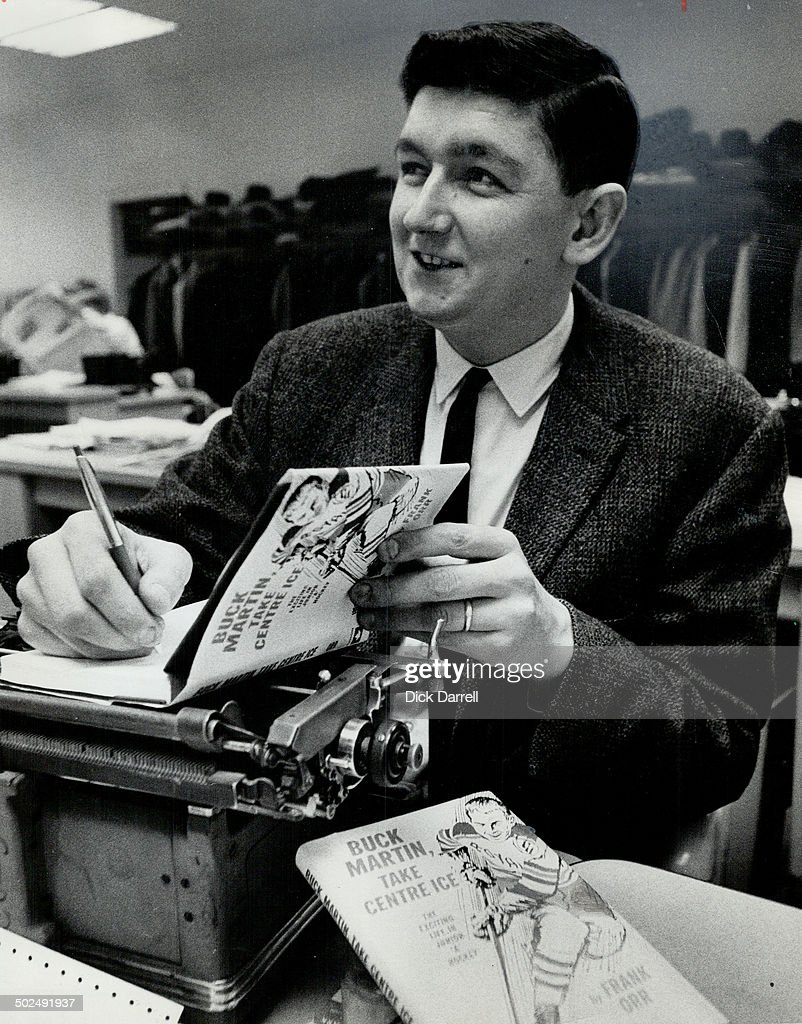 Star's Frank Orr autographs his first book. Novel deals with life of junior hockey player : News Photo