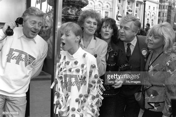Stars from the nation's favourite soaps form a queue to make their telephone pledges headed by TV presenter Michael Aspel at the launch of the ITV...