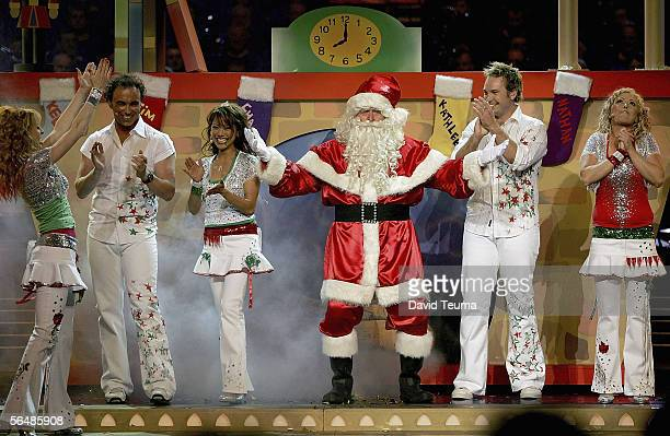 TV stars Hi Five Charli Robinson Nathan Foley Kathleen De Leon Tim Harding and Kelli Hoggart perform with Santa at the 2005 Carols by Candlelight on...