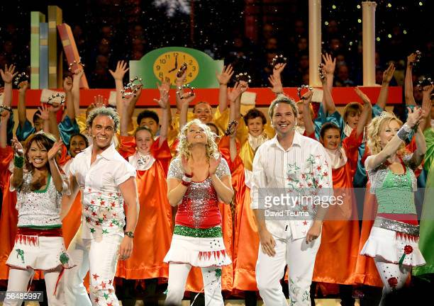 TV stars Hi Five Kathleen De Leon Nathan Foley Kelli Hoggart Tim Harding and Charli Robinson perform at the 2005 Carols by Candlelight on December 24...