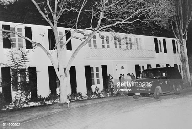 Star's Home in Murder Spotlight Beverly Hills California Newsmen and the coroner's van stand outside the Beverly Hills home of actress Lana Turner...