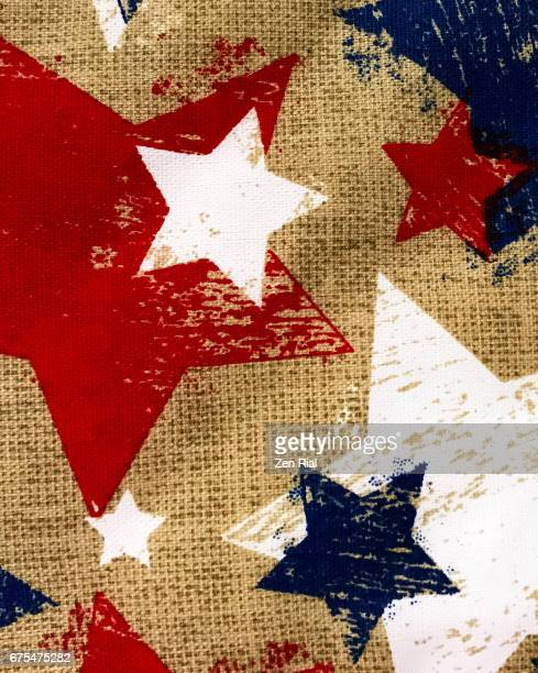 Stars in Red, White and Blue colors printed on brown background