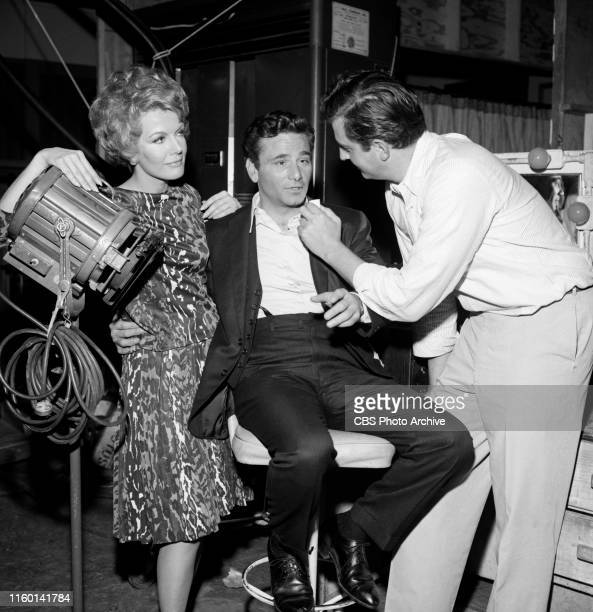 Stars Joanna Barnes and Peter Falk are photographed behind the scenes with Makeup artist John Jiras on the set of the CBS television legal drama The...