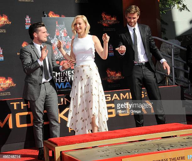 Stars Josh Hutcherson Jennifer Lawrence and Liam Hemsworth From Lionsgate's 'The Hunger Games Mockingjay Part 2' Hand And Footprint Ceremony held at...