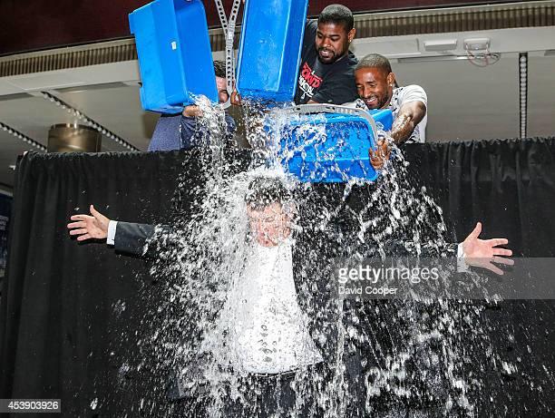 Stars Nazem Kadri, Amir Johnson, and Jermain Defoe, dump ice water on Tim Leiweke, as part of the Ice Bucket Challenge outside the Air Canada Centre...