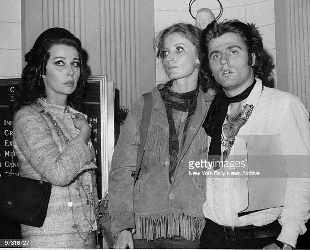 Stars of Andy Warhol's movies Ultra Violet Viva and Gerard Malanga in lobby of Columbus Hospital