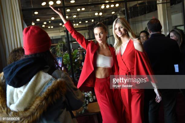 Stars of E's Model Squad Hannah Ferguson and Devon Windsor pose in the Etihad Airways VIP Lounge at NYFW The Shows on February 8 2018 in New York City
