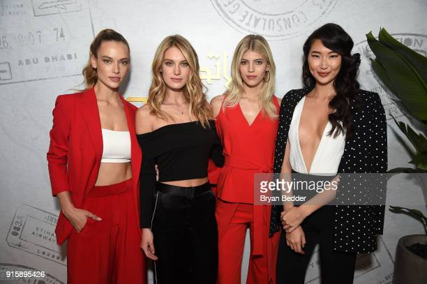 Stars of E's Model Squad Hannah Ferguson Caroline Lowe Devon Windsor and Ping Hue pose in the Etihad Airways VIP Lounge at NYFW The Shows on February...
