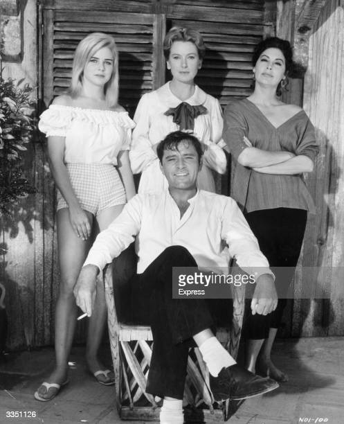 Stars of MGM film 'The Night of The Iguana' by Tennessee Williams directed by John Huston L to R standing Sue Lyon Deborah Kerr Ava Gardner and in...