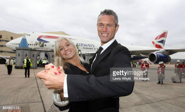 Stars of Strictly Come Dancing Mark Foster and his partner Hayley Holt dance in front of the British Airways jumbo jet at Heathrow that will be...