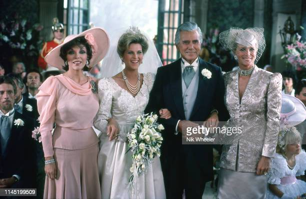 "Stars of television soap opera ""Dynasty"" pose for photo during filming of wedding scene location in Hollywood Los Angeles california USA circa 1985:"
