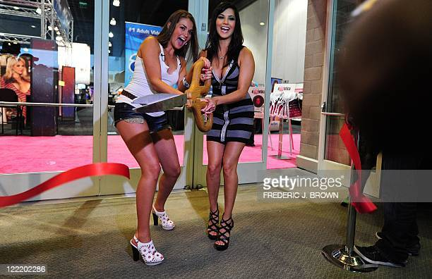 Stars of the adult entertainment industry Allie Haze and Sunny Leone cut the red ribbon to officially opening the the 2011 Exxxotica Expo on August...