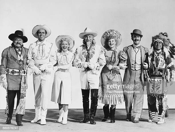 Stars of the American musical film 'Annie Get Your Gun' pictured together in costume in 1950 Edward Arnold Howard Keel Betty Hutton James Calkin...