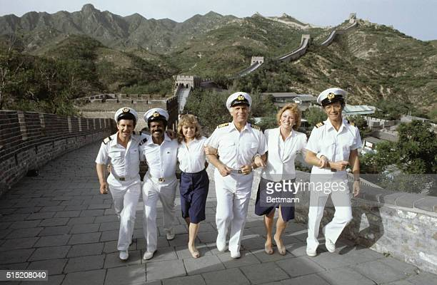 Stars of The Love Boat walk along the top of the Great Wall in Beijing From left to right are Fred Grandy who plays the purser Burl Gopher Smith Ted...
