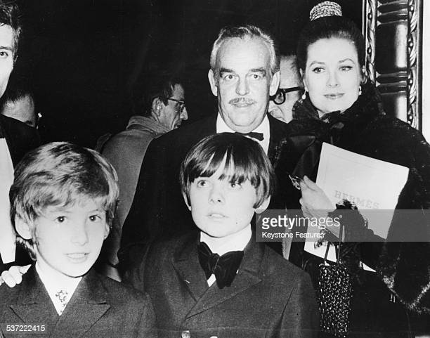 Stars of the musical film 'Oliver' Mark Lester and Jack Wild with Price Rainier and Princess Grace of Monaco at the films premiere circa 1968