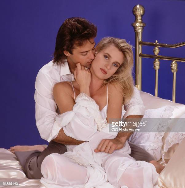 Stars of the nighttime television soap opera 'Knots Landing' American actor and game show winner Joseph Gian embraces Englishborn American actress...