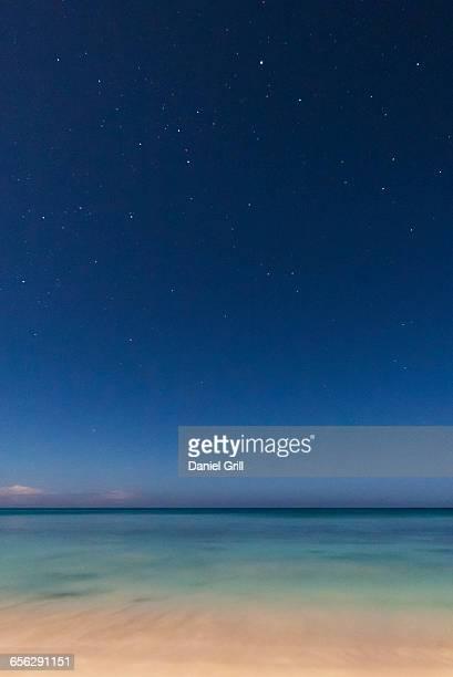 Stars on blue sky over sea