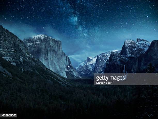 Stars over a snow covered El Capitan and Half Dome in Yosemite National Park