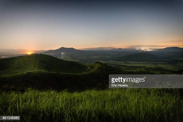 stars over jeju island landscape - jeju stock photos and pictures