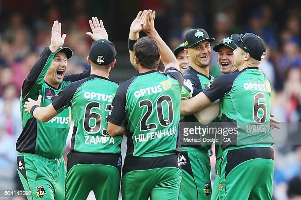 Stars players celebrate the wicket of Tom Cooper of the Renegades during the Big Bash League match between the Melbourne Renegades and the Melbourne...