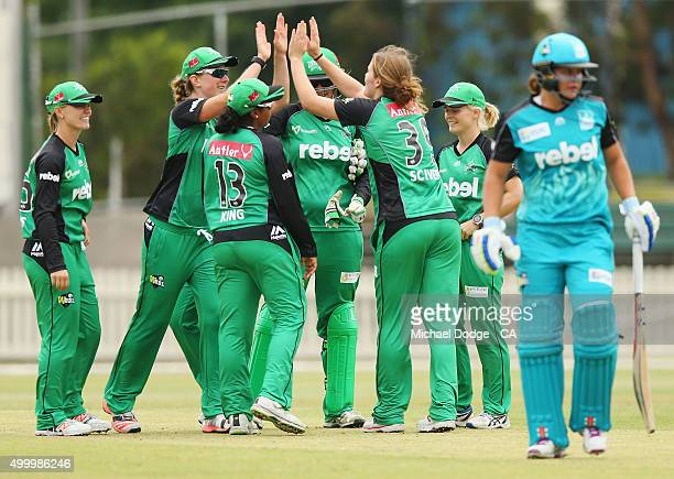 Stars players celebrate the win as Ash Barty of the Heat walks off during the Women's Big Bash League match between the Brisbane Heat and the...