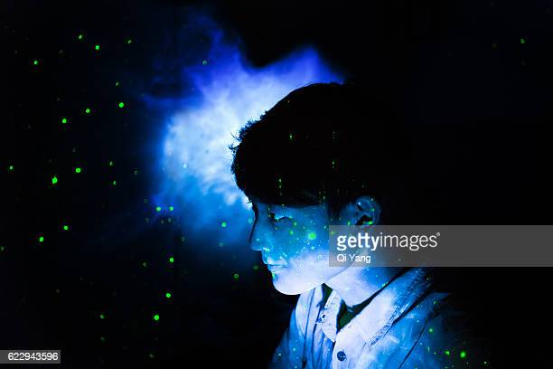 stars projected onto the young man's face - projektion stock-fotos und bilder