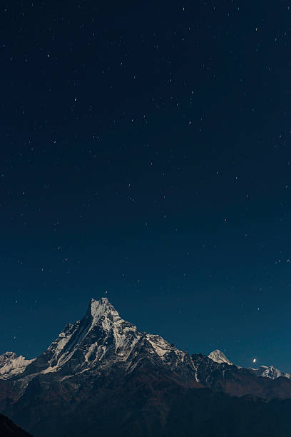 Stars shining over Machapuchare Fishtail mountain Himalayas Nepal