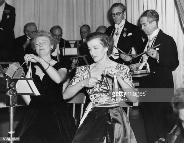 Stars take part in a performance of the 'Toy Symphony' at the Savoy Hotel in aid of the Musicians' Benevolent Fund 23rd November 1953 Wielding their...