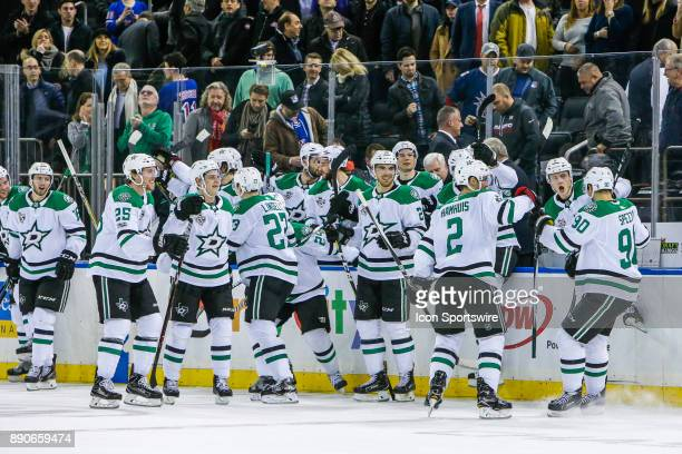 Stars teammates congratulate Dallas Stars Center Jason Spezza after he scores winning shootout goal during the Dallas Stars and New York Rangers NHL...