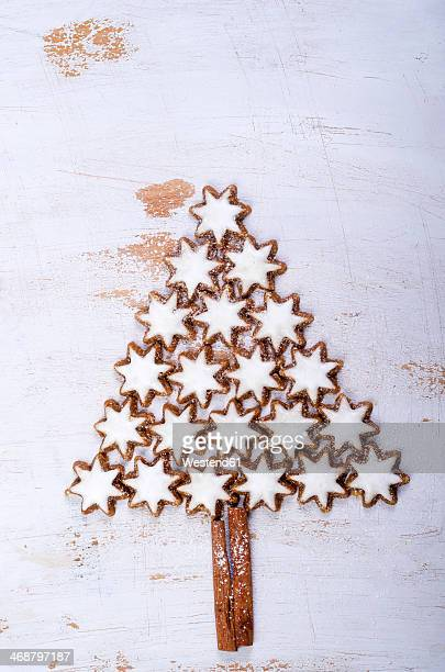 Star-shaped cinnemon cookies forming a fir tree